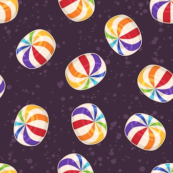 Modello senza cuciture di caramelle, con caramelle rotonde di zucchero duro su sfondo scuro