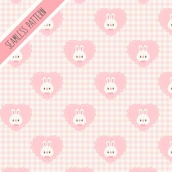 Modello senza cuciture di coniglio carino e cuore rosa. coniglietto disegnato a mano
