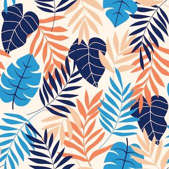 Modello senza cuciture di tendenza con foglie tropicali e colori vivaci