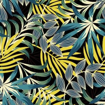 Modello senza cuciture di tendenza originale con brillanti foglie e piante tropicali