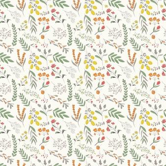 Modello senza cuciture floreale disegnato a mano, fiori colorati e fogliame sparsi