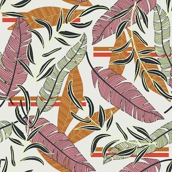Modello senza cuciture luminoso astratto con foglie e fiori tropicali colorati su delicato