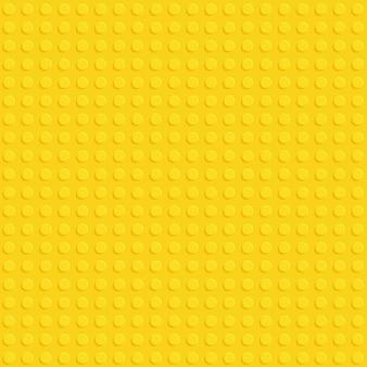 Modello senza cuciture piatto di plastica gialla blocco di costruzione