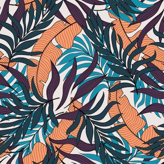 Modello senza cuciture tropicale astratto con fiori esotici colorati e piante in colore scuro