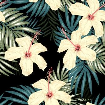 Modello senza cuciture tropicale con foglia di palma e fiori di ibisco