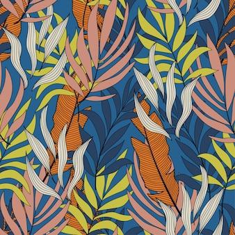 Modello senza cuciture tropicale con foglie e piante luminose gialle e rosa