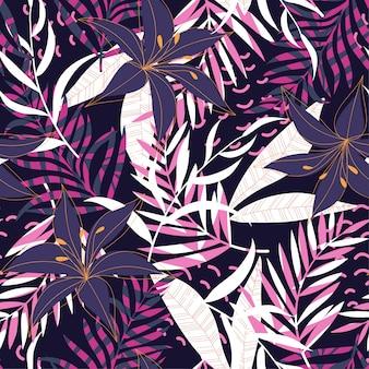 Modello senza cuciture tropicale con foglie e piante luminose su oscurità