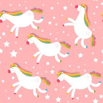Modello senza cuciture unicorno su uno sfondo rosa.