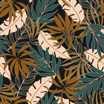 Modello tropicale senza cuciture alla moda con piante e foglie gialle e blu luminose