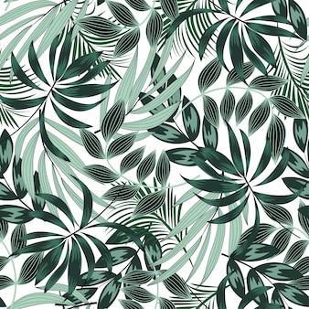 Modello tropicale senza cuciture alla moda con piante e foglie verde intenso
