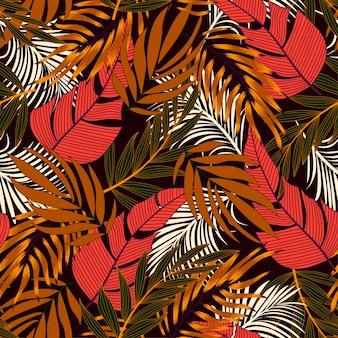 Modello tropicale senza cuciture astratto con le piante e le foglie rosse e arancio luminose