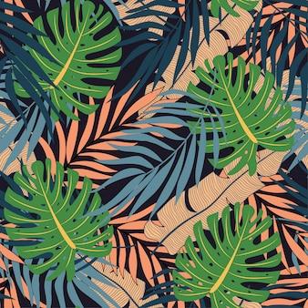 Modello tropicale senza cuciture d'avanguardia con piante e foglie