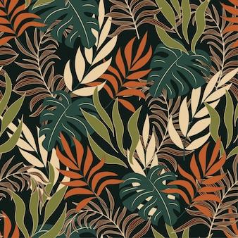 Modello tropicale senza cuciture di tendenza con foglie e piante arancio e bianche luminose