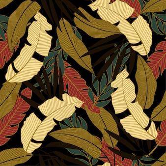 Modello tropicale senza cuciture di tendenza con foglie e piante gialle e rosse luminose