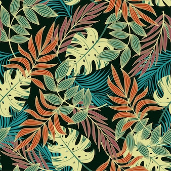 Modello tropicale senza cuciture originale con foglie e piante di arancio brillante