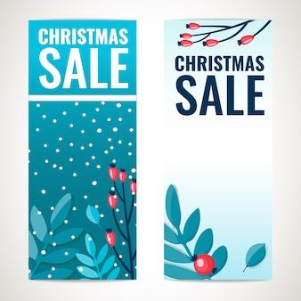 Modello verticale di progettazione dell'insegna di vendita di natale con i ramoscelli di inverno con le bacche, decorazione di feste