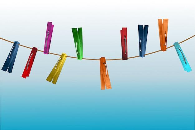 Mollette da bucato su una corda su una sfumatura blu chiaro