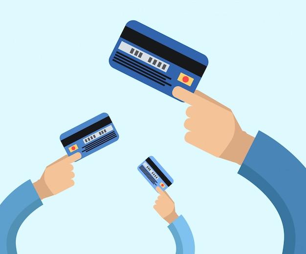 Molte mani tengono un'illustrazione piana delle carte di credito