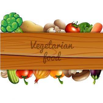 Molte verdure e cartello in legno