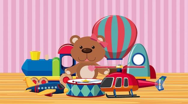 Molti giocattoli carini sul pavimento di legno