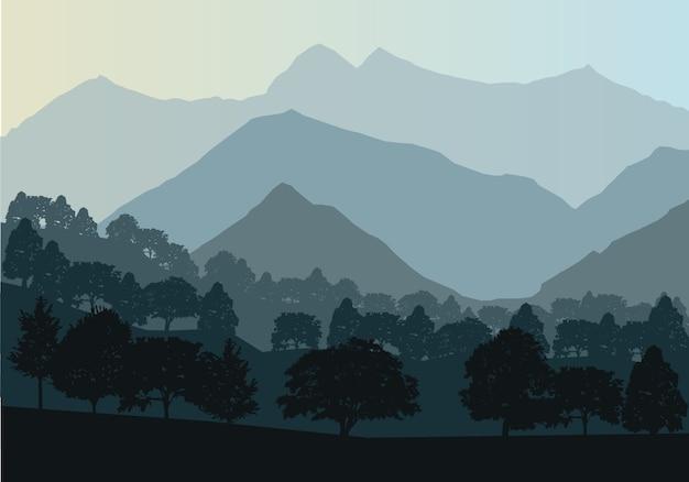 Montagne e paesaggio forestale nelle prime ore del giorno.