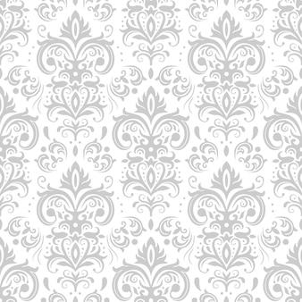 Motivo damascato decorativo. ornamento d'epoca, fiori barocchi e ornamenti floreali ornato veneziano d'argento senza cuciture