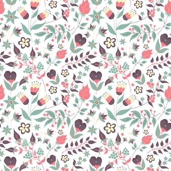 Motivo floreale senza soluzione di continuità con doodle fiori e foglie.