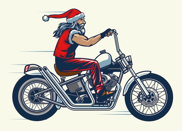 Motociclista in sella alla bici chopper e vestito in costume di babbo natale