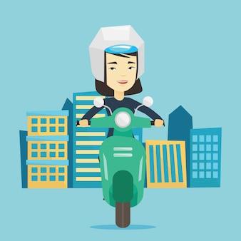 Motorino di guida della donna in città.