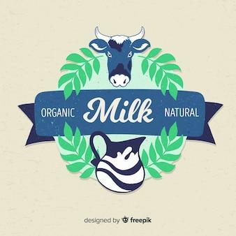 Mucca con foglie di latte logo