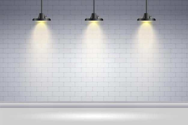 Muro di mattoni bianco del fondo delle luci del punto