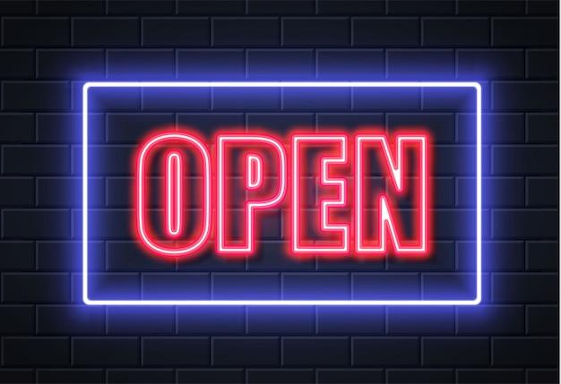 Muro di mattoni del segno aperto al neon