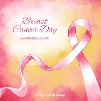 Nastro di consapevolezza del cancro al seno dell'acquerello su sfondo sfumato