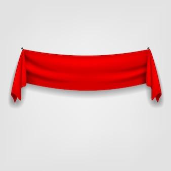 Nastro rosso che appende sui chiodi isolati