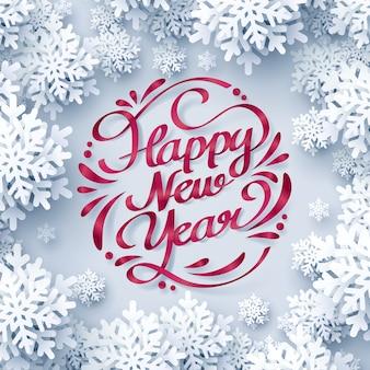 Nastro rosso di felice anno nuovo calligrafia scritte a mano e fiocco di neve