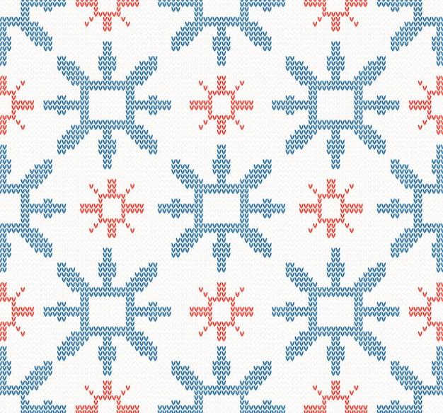 Natale a maglia senza cuciture con fiocchi di neve blu e rossi