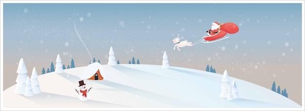 Natale bianco nel villaggio rurale con babbo natale
