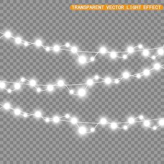 Natale luminoso, belle luci, elementi di design. luci incandescenti per la progettazione di biglietti di auguri di natale. ghirlande, decorazioni natalizie chiare.