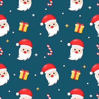 Natale seamless con santa isolato su sfondo blu.
