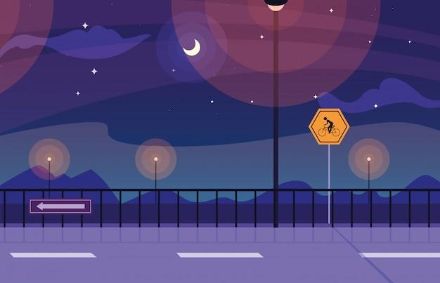 Natura del paesaggio notturno con segnaletica per ciclista