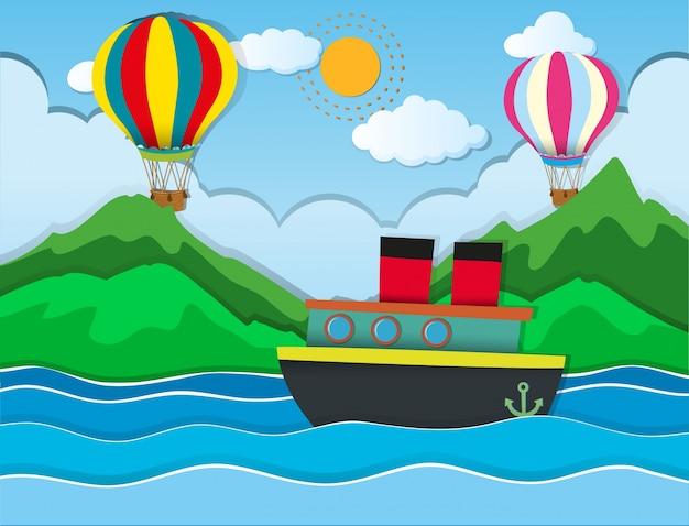 Nave in navigazione in mare e palloncini che volano in cielo