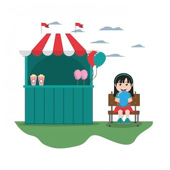 Negozio di carnevale e ragazza con posti a sedere palloncino