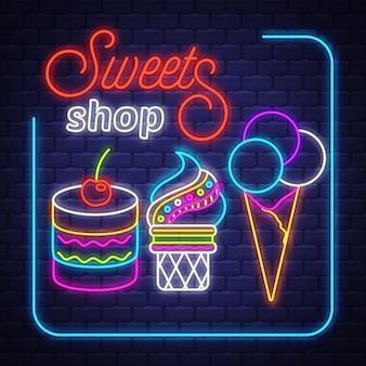 Negozio di dolci al neon vettore. negozio di dolci - insegna al neon sul fondo del muro di mattoni