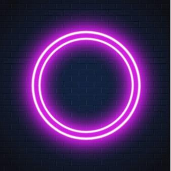 Neon viola cerchio cornice segno muro di mattoni