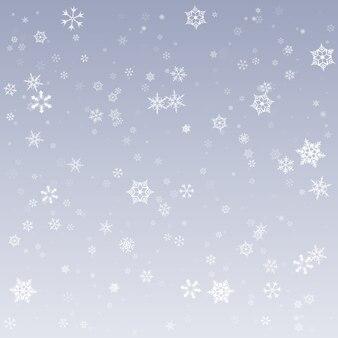 Neve che cade su uno sfondo invernale.