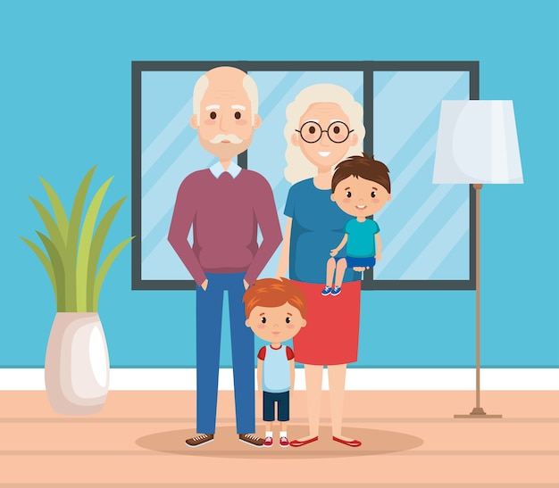 Nonni con i nipoti nel soggiorno