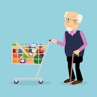 Nonno con carrello della spesa con generi alimentari