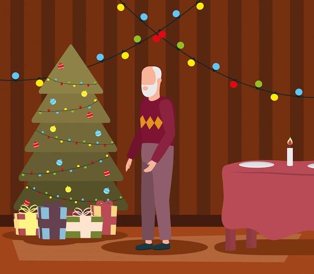 Nonno in soggiorno con decorazioni natalizie
