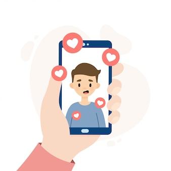 Notifiche sui social media. persona circondata da cuori / mi piace. mano che tiene uno smartphone.