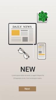 Notizie quotidiane su schermi di smartphone e tablet mass media di comunicazione online per applicazioni di giornali